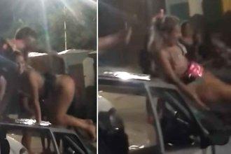 Descontrol en Gualeguaychú: Dos chicas abollan un auto bailando sobre el techo