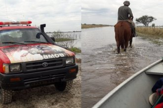 Con lancha y remos, Bomberos rescataron a una familia que había quedado incomunicada por la inundación