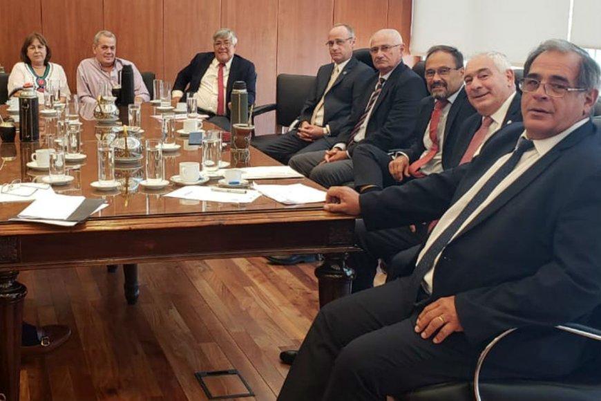 Carbonell, junto a Benítez y García en la reunión.
